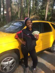 We buy cars for cash like this yellow Pontiac Aztec in Lithonia GA.